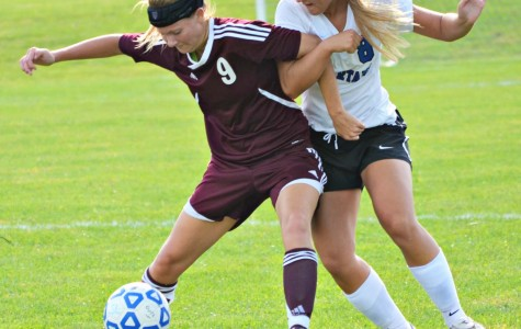 A member of the Southern Lehigh girls' soccer team takes on an opponent.