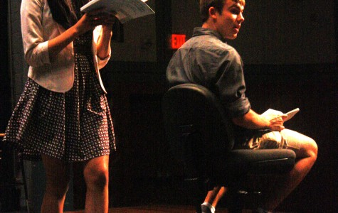Cast members Gabby Dalope and Aidan McLoughlin rehearse their lines together.