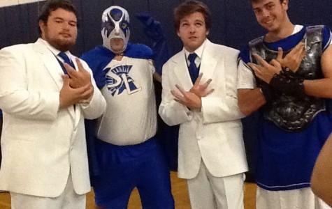 The stars of the 2012 Homecoming pep rally: senior Austin Rivera, Mr. David Dougherty, junior Ryan McGinty, and Mr. Spartan, Wesley Flack