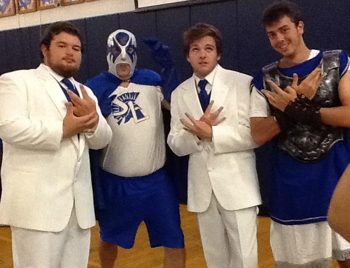 The stars of the 2012 Homecoming pep rally: senior Austin Rivera, Mr. David Dougherty, junior Ryan McGinty, and Mr. Spartan, Wesley Flack