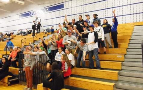 The student section cheers to get a t shirt from the cheerleaders.