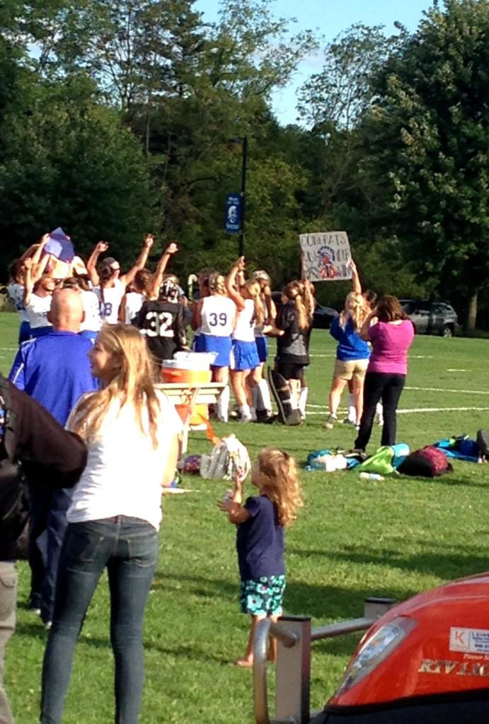 Fans cheer for Mrs. Searfoss and the field hockey team.