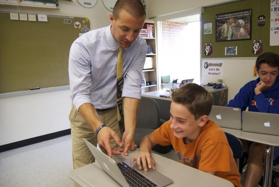 Mr. Paul Sabino assists a student.