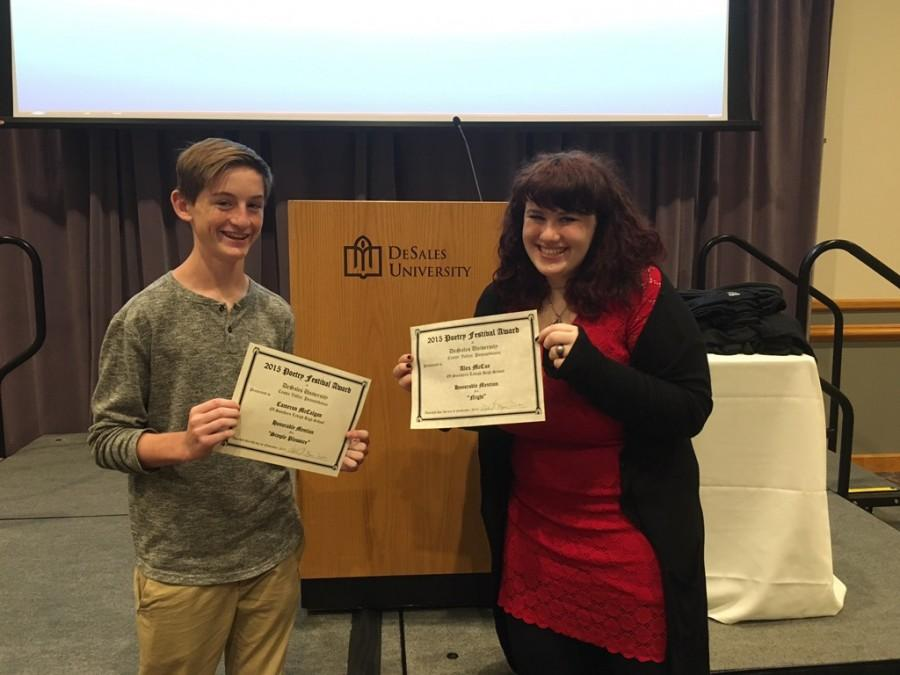 Junior Alex McCue and freshman Cameron McColgan pose with their honorable mention certificates.