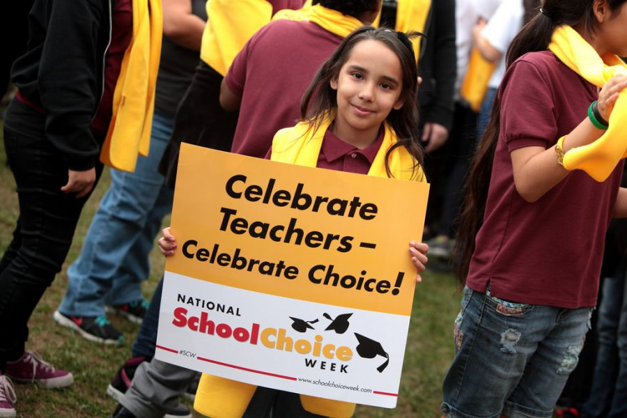 A student attends a School Choice Week rally in Phoenix, Arizona.