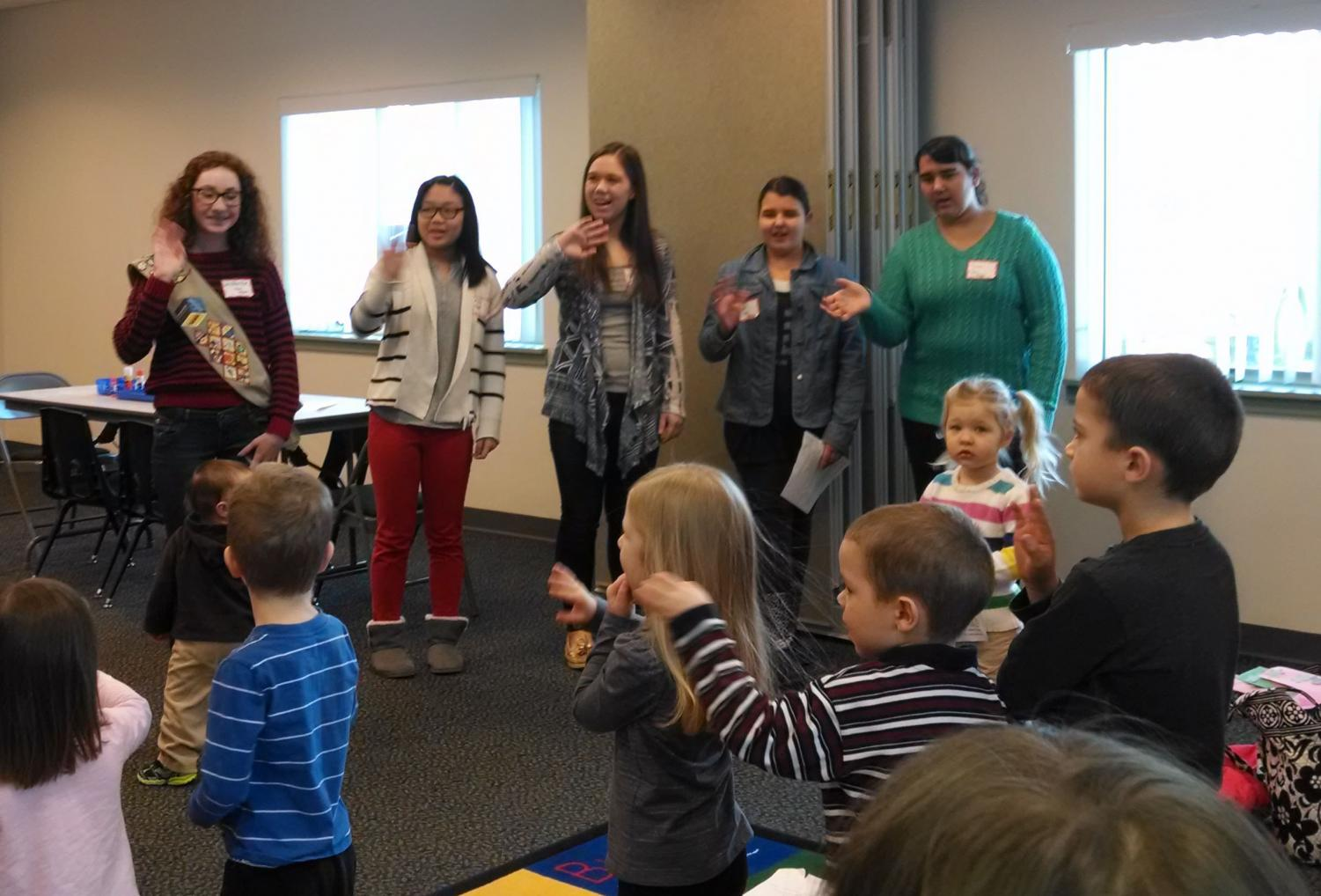 Girl Scout troop 6467 from Southern Lehigh High School teach a group of young children during a program about Doctor Seuss.