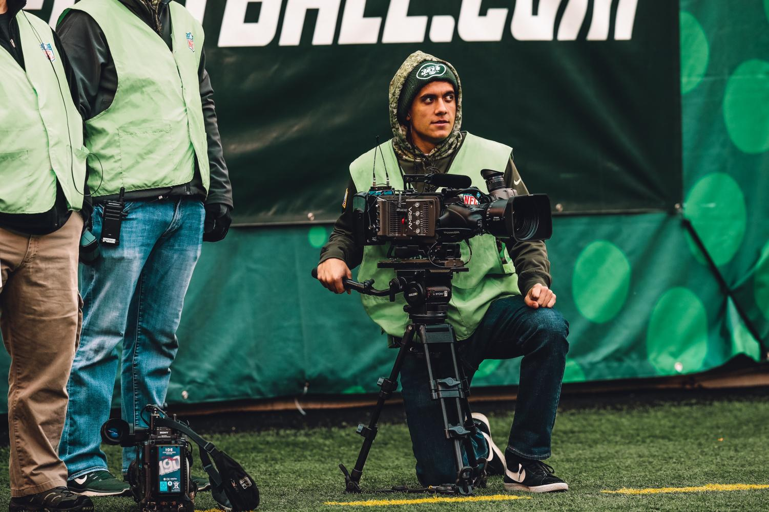 Pino films a Jets game from the sidelines.