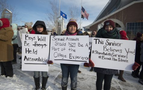 Protesters rally to stand with rape survivors.