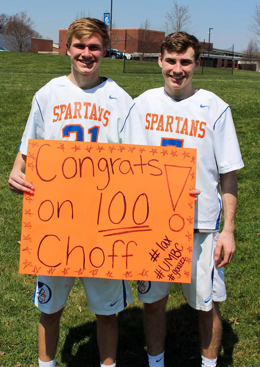 Colin and Kyle celebrate Colin's 100th goal.