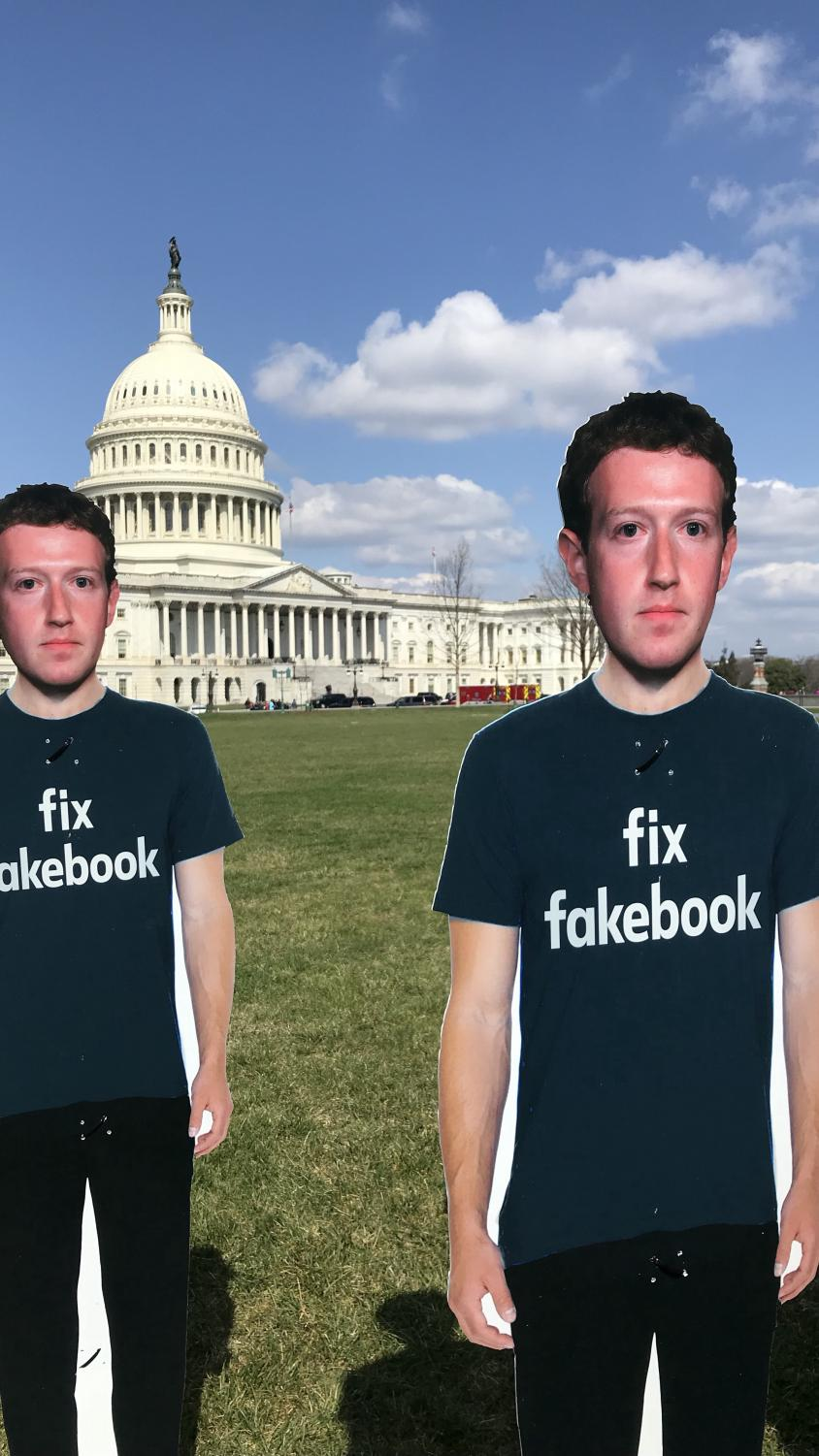 During the trial, these cardboard cutouts of Zuckerberg were placed on the lawn of the Capitol.