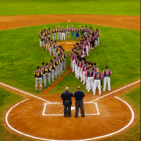 Members of rival teams Southern Lehigh and Saucon Valley came together to form a cancer ribbon on the field.
