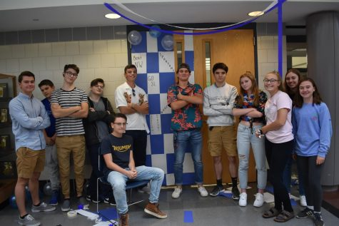 This advisory class is proud of their work for the door decorating contest.