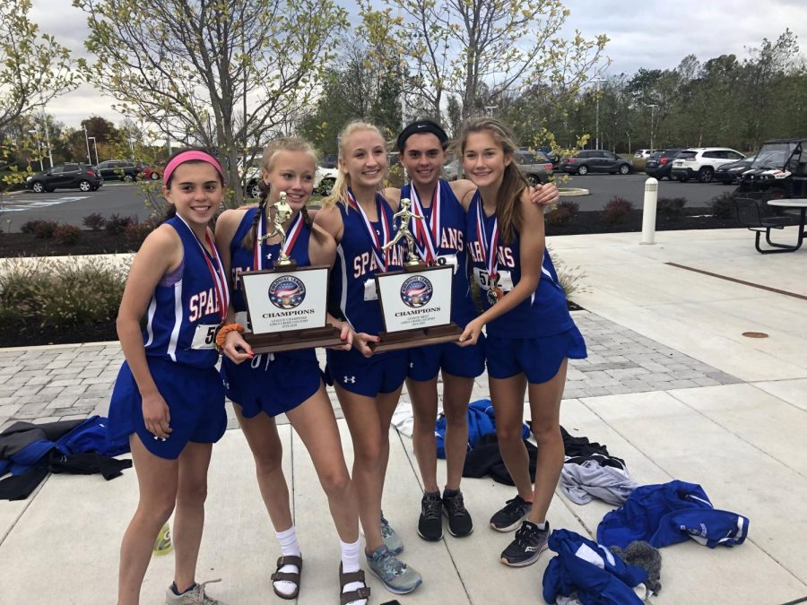 The top girls cross country runners proudly display their