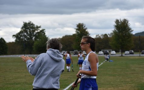 Coach Adrienne Searfoss gives advice to Senior Captain Theresa Stoudt before a game.