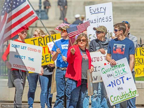 Protestors in Ohio wave American flags as they protest against the Stay-at-Home orders.